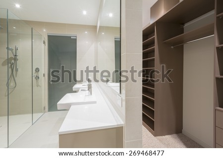 Spacious contemporary bathroom with shower and walk in robe