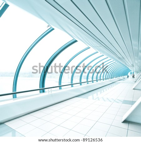 spacious corridor in contemporary airport walkway - stock photo