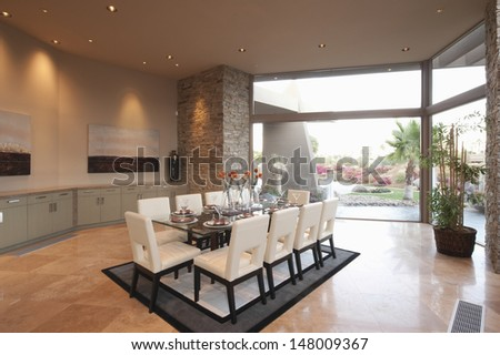 Spacious dining room with floor to ceiling windows