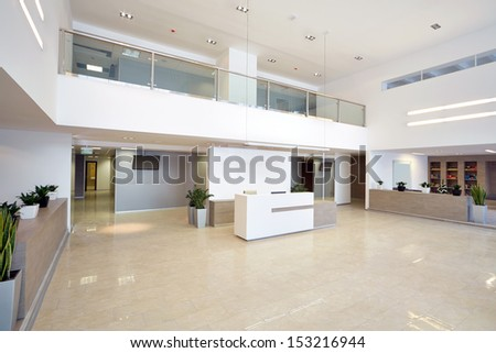Spacious empty reception hall in modern building - stock photo