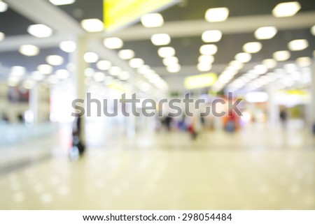 Spacious hall of airport out of focus - defocused blured background - stock photo
