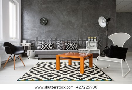 Spacious Living Room Decorated In Black And White Colors. In The Middle  Orange Coffee Table Part 85