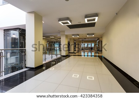 Spacious, modern design university hall in black and white