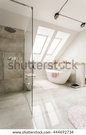 Spacious  new design  attic bathroom with glass walk in shower, bathroom and high gloss tiling