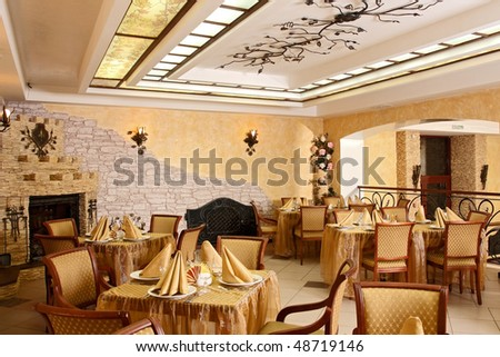 Spacious restaurant with the big fireplace - stock photo