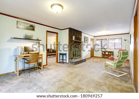 Spacious room with carpet floor, fireplace. Furnished with desk, chairs and bookshelf