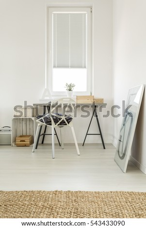 Spacious stylish living room with workplace in the corner