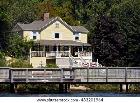 spacious summer cottage on a river with patriotic flag bunting decoration