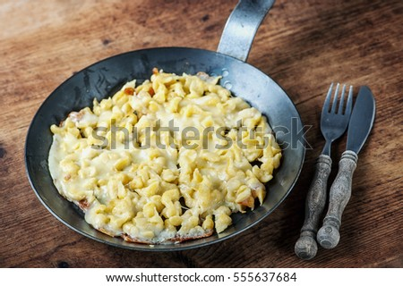 spaetzle with melted cheese in pan