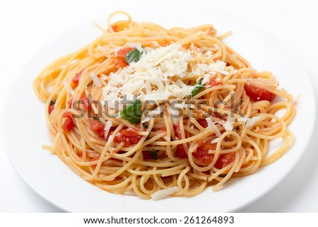 Spaghetti al pomodoro, one of the simplest Italian rustic dishes with the pasta tossed in a sauce of tomato, basil, garlic and a little sugar and oil.