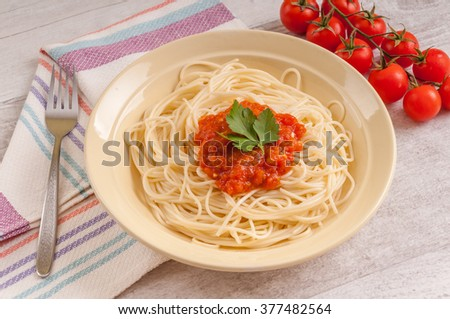 Spaghetti and home made tomato sauce,