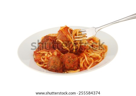 Spaghetti and meatballs in a bowl with a fork isolated against white - stock photo