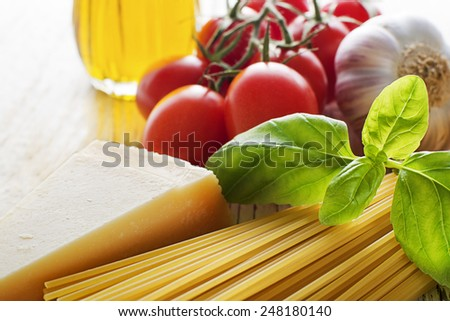 Spaghetti and tomatoes with parmesan cheese close up - stock photo