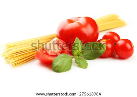 Spaghetti, basil and tomatoes isolated on white - stock photo