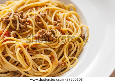 Spaghetti Bolognese in a white bowl - stock photo