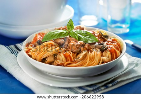 spaghetti bolognese in white plate on table - stock photo