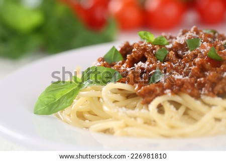 Spaghetti Bolognese noodles pasta meal with tomatoes on a plate - stock photo