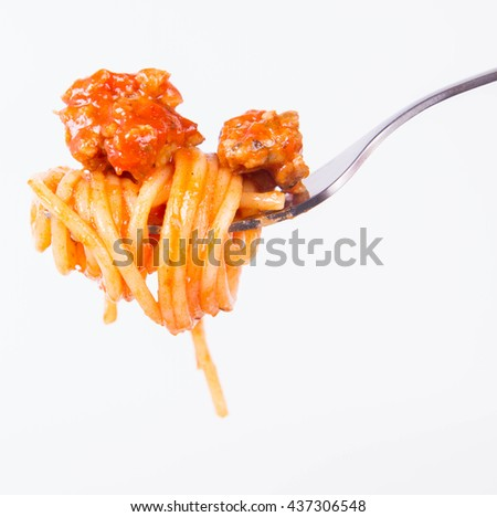 Spaghetti bolognese on a fork - stock photo