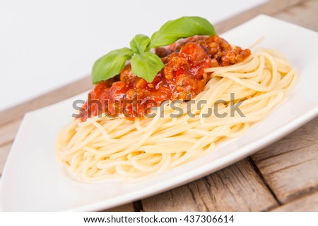 Spaghetti bolognese on a plate on a wooden background