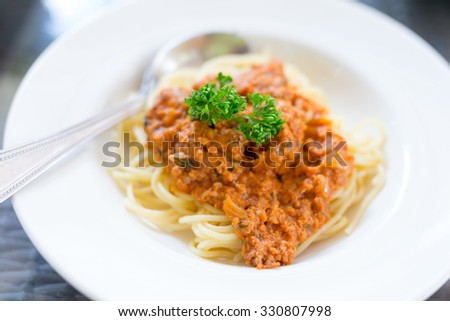 Spaghetti Bolognese on white dish - stock photo