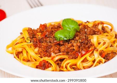 spaghetti bolognese on white plate - stock photo