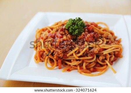 spaghetti bolognese on wood background - stock photo