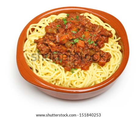 Spaghetti bolognese served in a terracotta dish.