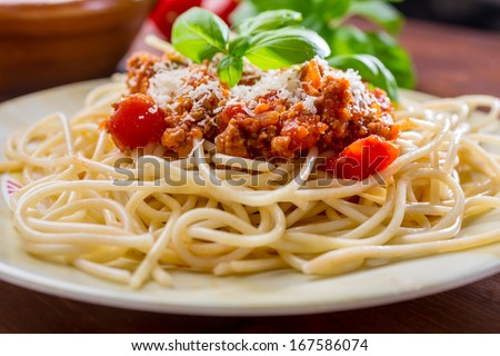 Spaghetti Bolognese with cheese and basil - stock photo