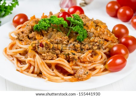 Spaghetti bolognese with cherry tomatoes and parsley - stock photo