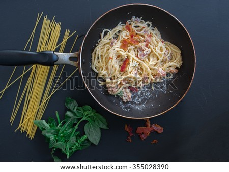 Spaghetti Carbonara with bacon and cheese in a pan. Top view - stock photo