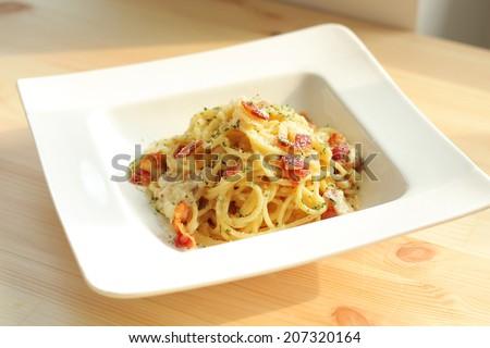 Spaghetti Carbonara with bacon serve on white modern plate - stock photo