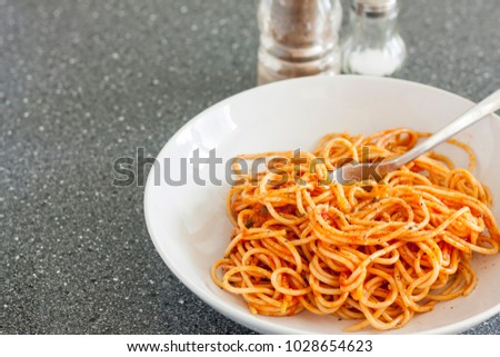 Spaghetti in a tomato sauce served with black pepper