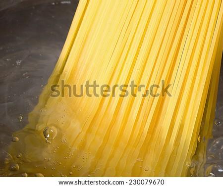 spaghetti in hot water - stock photo