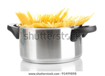 Spaghetti in pot isolated on white - stock photo