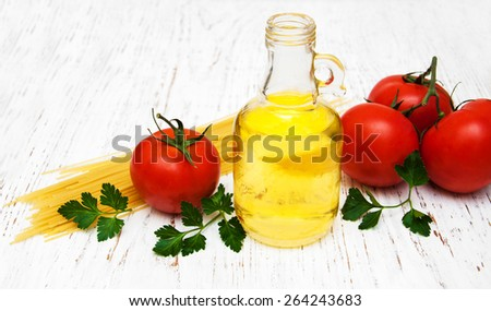 spaghetti ingredients on a old wooden background
