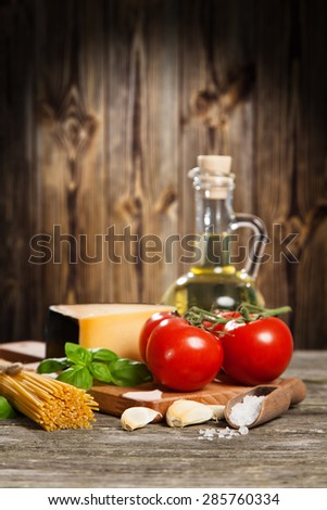 Spaghetti ingredients on wooden background