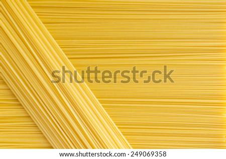 Spaghetti lying horizontally and diagonally - stock photo