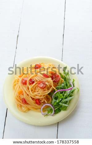 Spaghetti marinara pasta salad with arugula