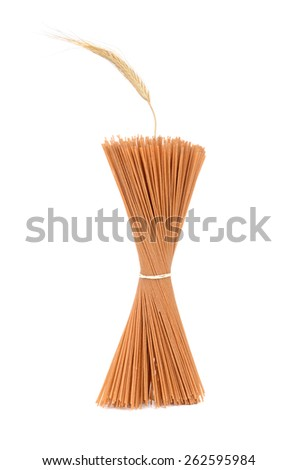 spaghetti noodles and wheat straw isolated on white background - stock photo
