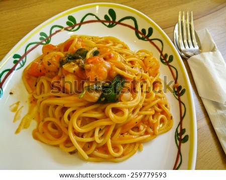 Spaghetti on a plate on the table.