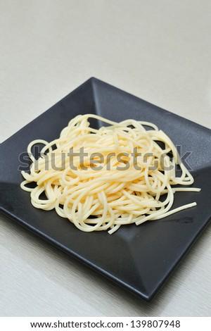 spaghetti on dish no sauce - stock photo