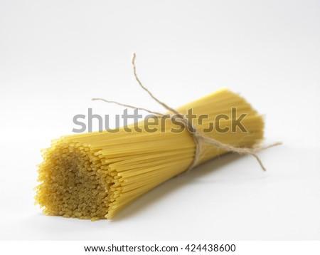 spaghetti on the whit background - stock photo