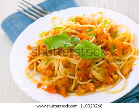 Spaghetti on white plate - stock photo