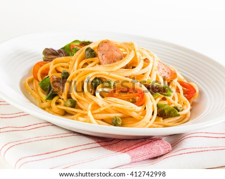 Spaghetti on white table