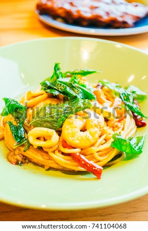 Spaghetti or pasta spicy seafood in plate - Italian food style