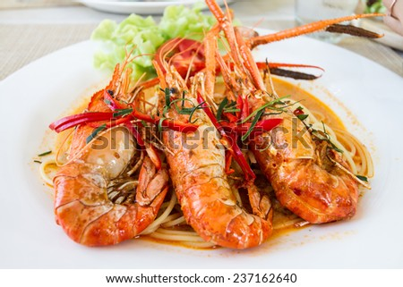 Spaghetti Panaeng Goong, spicy curry thai style pasta with river prawn - stock photo
