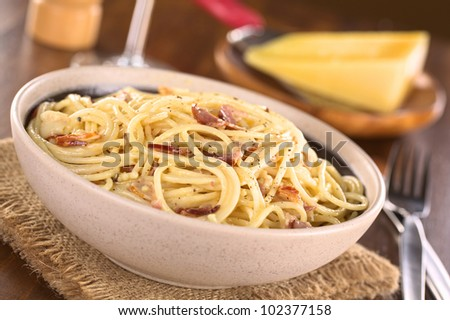 with bacon, eggs, cheese, black pepper in bowl with parmesan cheese ...