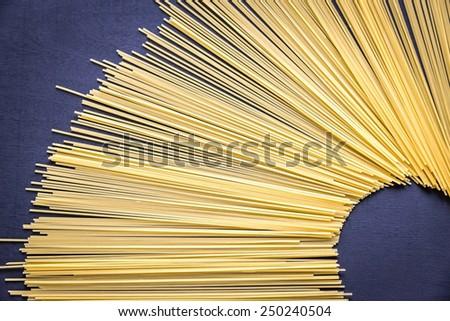 Spaghetti pasta on the dark background - stock photo