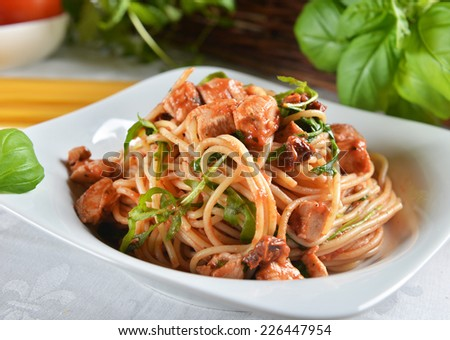 spaghetti pasta with chicken and arugula - stock photo