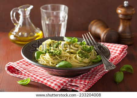 spaghetti pasta with pesto sauce over rustic table - stock photo